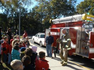 Firefighter and fire truck visit school to discuss Fire Safety